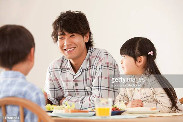 Father with Two Children at Breakfast Table