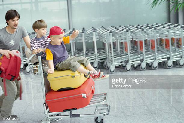 Father with two sons at the airport