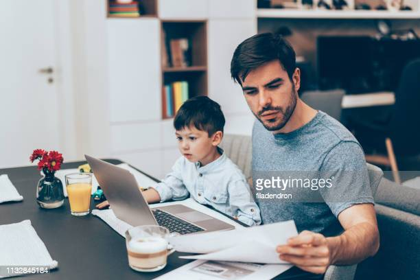 father working at home - multi tasking stock pictures, royalty-free photos & images