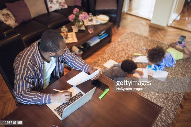 father working from home - home office stock pictures, royalty-free photos & images