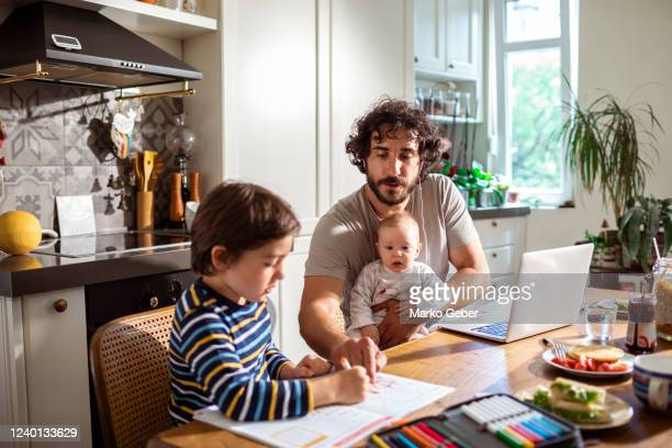 father working from home with his kdis - parenting stock pictures, royalty-free photos & images