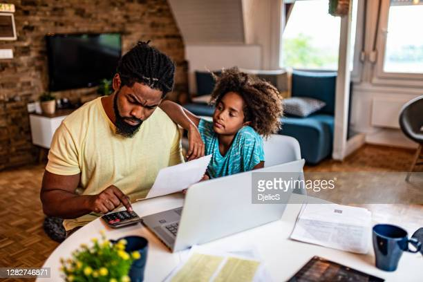 father working while his daughter is supporting him. - fee stock pictures, royalty-free photos & images