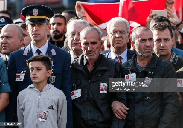 A father Yucel Ulus and Student of University of National Defense Air NCO Higher Vocational School Cagri Ulas attend the funeral ceremony of...