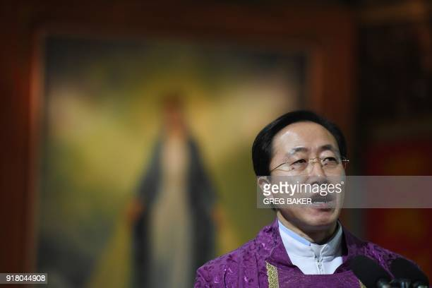 Father Zhao Qinglong speaks during a mass on Ash Wednesday which marks the beginning of Lent at Beijing's government sanctioned South Cathedral on...