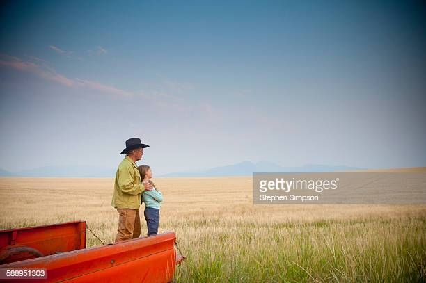 father/daughter stand in back of old pickup truck - old truck stock pictures, royalty-free photos & images