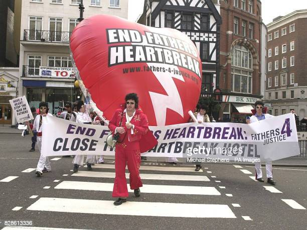 Fathers 4 Justice arriving at the Royal Courts of Justice, London, dressed as Elvis Presley. The campaign group were to deliver their own special...