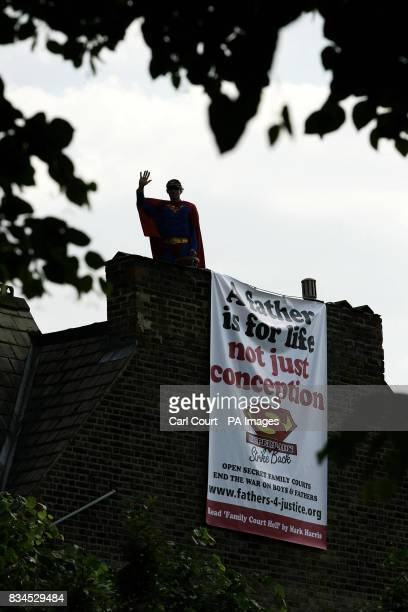 Fathers 4 Justice campaigner Jolly Stanesby waves from the roof of Cabinet Minister Harriet Harman's house in Herne Hill, London.