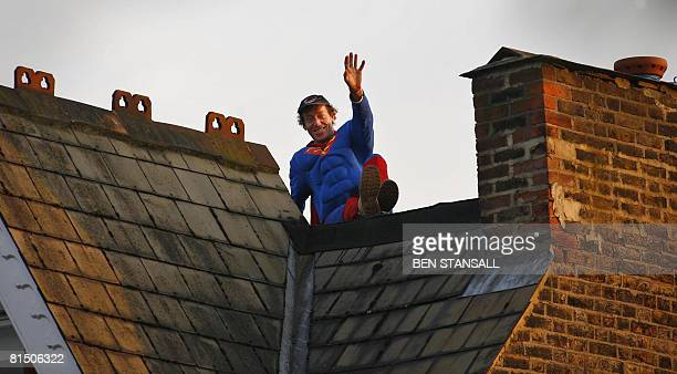 """Fathers 4 Justice"""" member wearing a Superman outfit waves as he sits on top of Deputy Labour Leader Harriet Harman's home on June 8, 2008 in south..."""