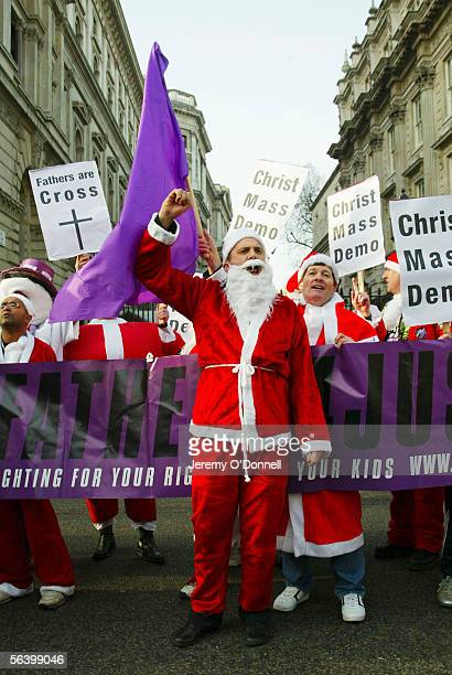 Father's 4 Justice National Spokesman Glen Poole speaks outside Downing Street during a Fathers 4 Justice christmas campaign march, from the Church...