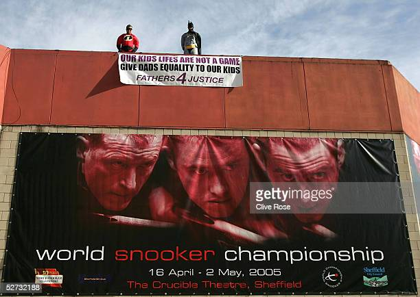 Fathers 4 Justice' protesters stand on the roof during the Embassy World Snooker Finals at the Crucible Theatre on April 29, 2005 in Sheffield,...