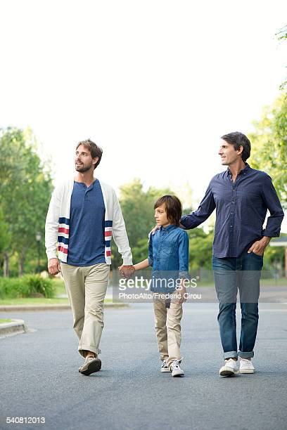 Fathers and son walking together outdoors