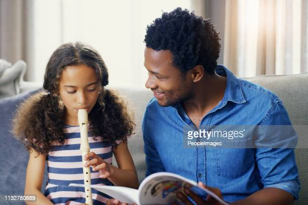 father's are often the first teachers  in their children's lives - recorder musical instrument stock photos and pictures
