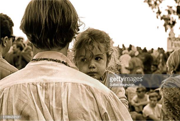 Father's back as he hold his young daughter at the 1st Elysian Park Love-In on March 26, 1967 in Los Angeles, California.