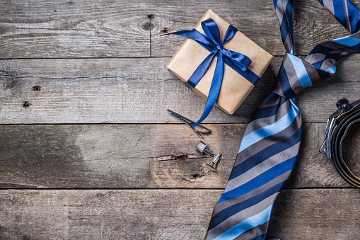 Father's day concept - present, tie on rustic wood background 1013428178