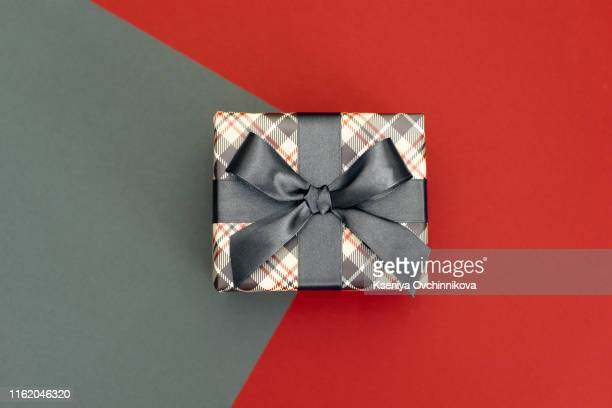 father's day holiday greeting card.mug tea coffee and present gift box tag on wooden table blur lights background empty space.love you dad message. - masculinity stock pictures, royalty-free photos & images