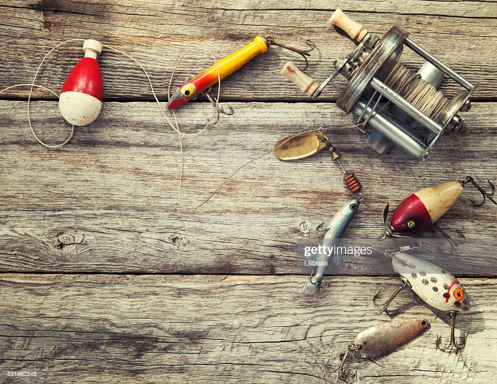 Fishing Tackle On Wood Background