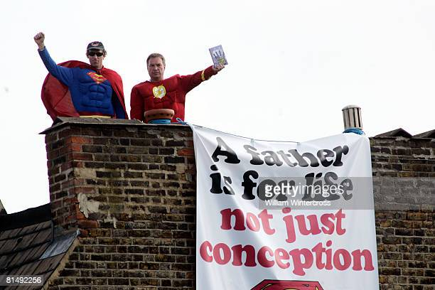 'Fathers for Justice' campaigners stand atop Deputy Labour Leader Harriet Harman's home on June 8, 2008 in south London. Protesting fathers' unequal...