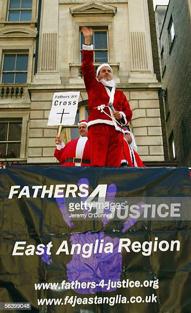 Father's For Justice National Spokesman Glen Poole speaks during a Fathers 4 Justice christmas campaign march, from the Church of England headquaters...