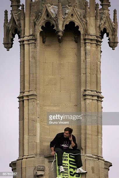 Fathers for Justice protestor Guy Harrison is seen on the roof of the Houses of Parliament, September 27, 2005 in London. Fathers 4 Justice is a UK...