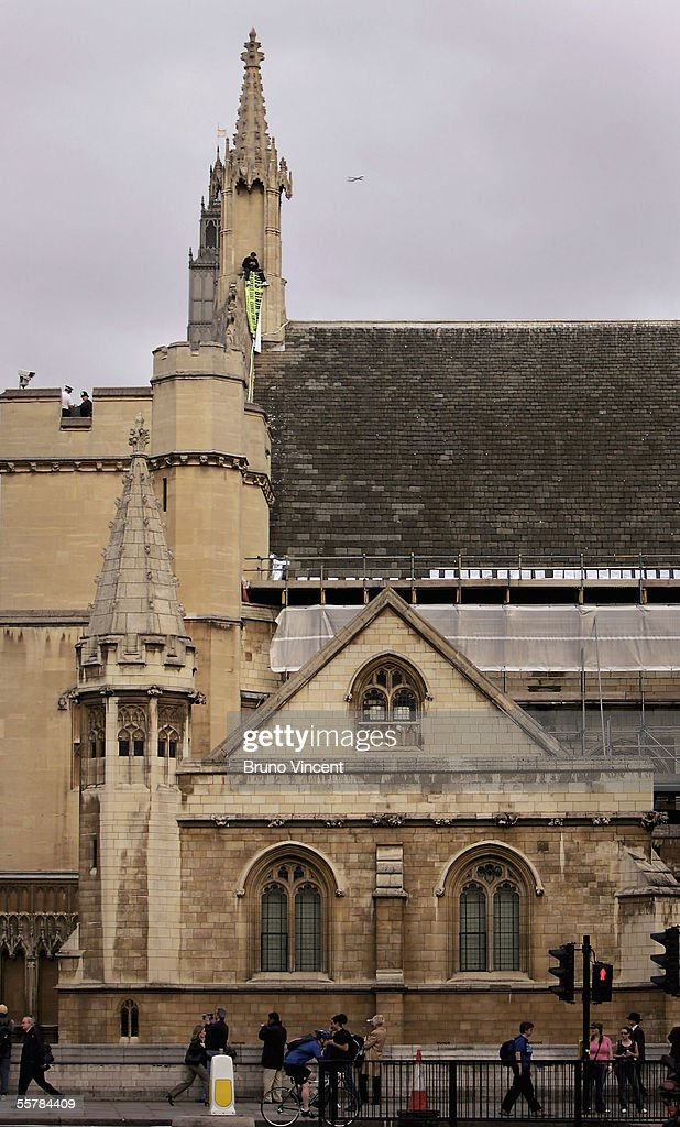 Protestor Scales The Houses Of Parliament : News Photo