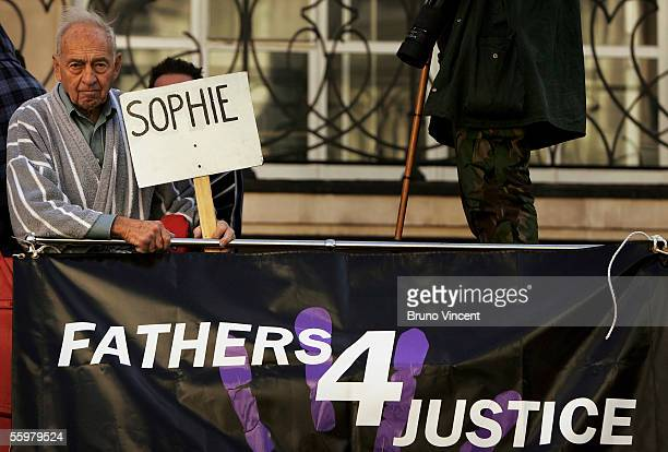 Fathers For Justice protestor holds a plaquard aboard a bus infront of the Royal Courts of Justice on October 21, 2005 in London.
