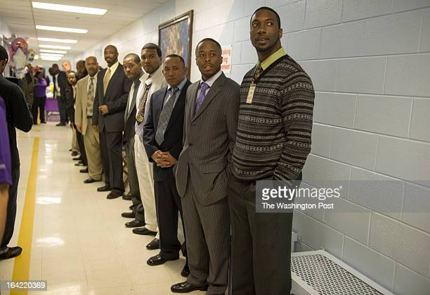 Fathers incarcerated at the Richmond City Jail line the narrow hallways to get a glimpse of their daughters who came for a visit for the Date with...