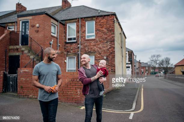 fathers walking with their little boy - stereotypically working class stock pictures, royalty-free photos & images