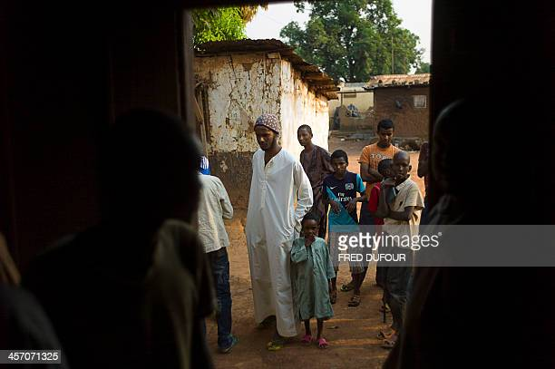 Fathi Azoulou stands among muslims and catholics people front of a mosque of Kina neighborhood an area where members of the two religions decided to...