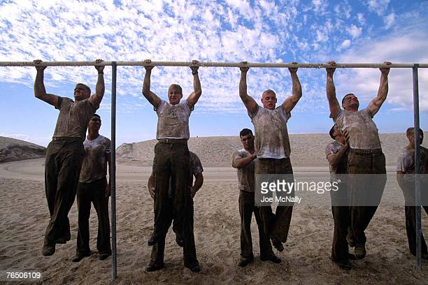 Fatigued Navy Seals struggle to do pull ups in August of 2005 on the beach at Hell Week training in Coronado California Hell Week at this beach in...