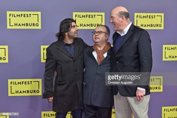 Fatih Akin Albert Wiederspiel and John Carroll Lynch attend the premiere of 'Lucky' during the opening night of Hamburg Film Festival 2017 at...