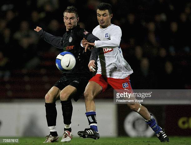 Fatih Altundag of Hamburg tussles for the ball with Marvin Braun of St. Pauli during the Oddset Cup match between FC St.Pauli and Hamburger SV II at...
