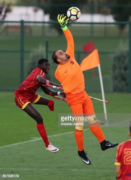 Fatih Karakus of Turkey in action against Roberto Carlos of Spain during the European Amputee Football Federation European Championship match between...