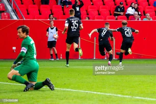 Fatih Kaya , Filip Bilbija and Jalen Hawkins of FC Ingolstadt 04 celebrate scoring the 2:1 during the DFB Cup first round match between FC Ingolstadt...
