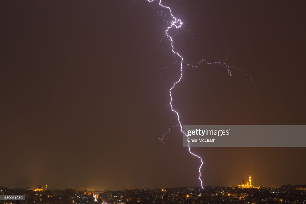 Fatih Mosque is seen as lightning strikes over the Istanbul skyline during a thunderstorm on May 7, 2017 in Istanbul, Turkey.