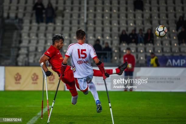 Fatih Senturk of Turkey is seen in action against Andreu Oros of Spain during the finals of Amp Futbol EURO 2021 in Krakow, Poland on September 19,...