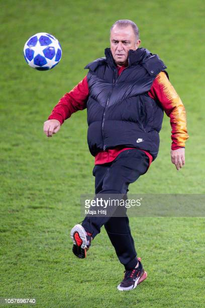 Fatih Terim head coach of Galatasaray plays with the ball during the Training prior to the Group D match of the UEFA Champions League between FC...