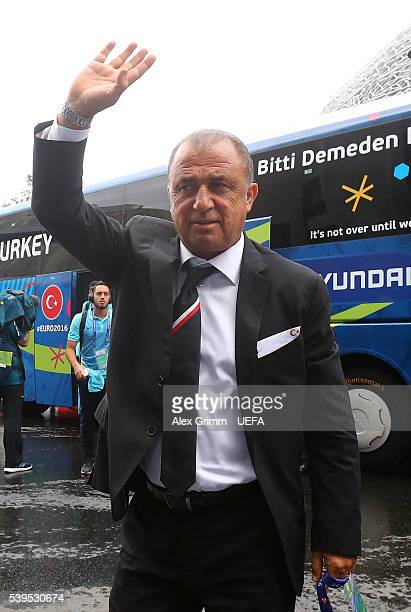 Fatih Terim head coach of Turkey waves to fans on arrival at the stadium prior to the UEFA EURO 2016 Group D match between Turkey and Croatia at Parc...