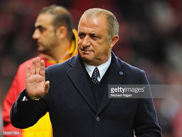 Fatih Terim manager of Galatasaray waves prior to the UEFA Champions League Group H match between Manchester United and Galatasaray at Old Trafford...