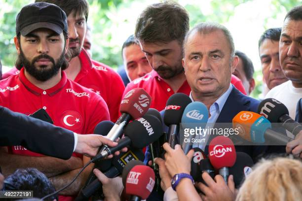 Fatih Terim the Manger of the Turkish national football team addresses members of the media following a visit by members of the Turkish national...