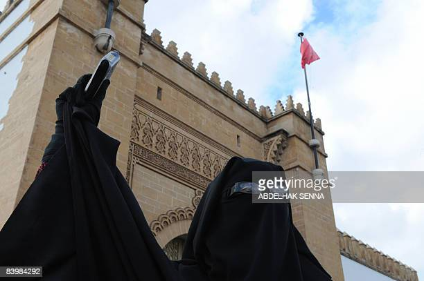 Fatiha Houssaini wife of jailed Salafist Omar Maarouf protests outside the headquarters of the council of human rights in Casablanca in Rabat on...
