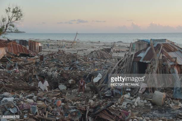 Fatilea is seen in her shelter in the commune of RocheaBateaux southwestern Haiti on February 25 next to the debris left after the passage of...