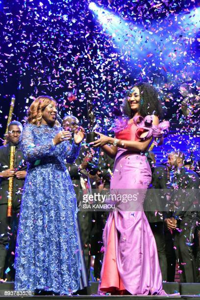 Fatim Sidime receives an award from Ivory Coast's Education Minister Kandia Camara during the 8th African Model Exhibition Awards on December 15 in...