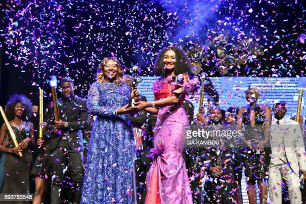 TOPSHOT Fatim Sidime receives an award from Ivory Coast's Education Minister Kandia Camara during the 8th African Model Exhibition Awards on December...