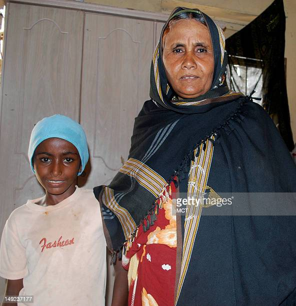 Fatima Ahmed stands with her ten-year old niece Amina in this photo shot in July 2012. Ahmed shares her one-room home in Beit al Fiqih with over two...