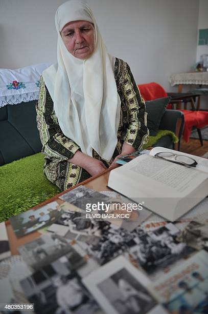 Fatima Aljic a Bosnian Muslim woman survivor of the 1995 Srebrenica massacre reads documents in her home in Sarajevo on July 5 as pictures of her...
