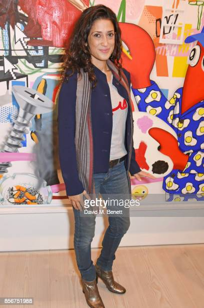 Fatima Bhutto attends a private view of Philip Colbert New Paintings at The Saatchi Gallery on October 2 2017 in London England