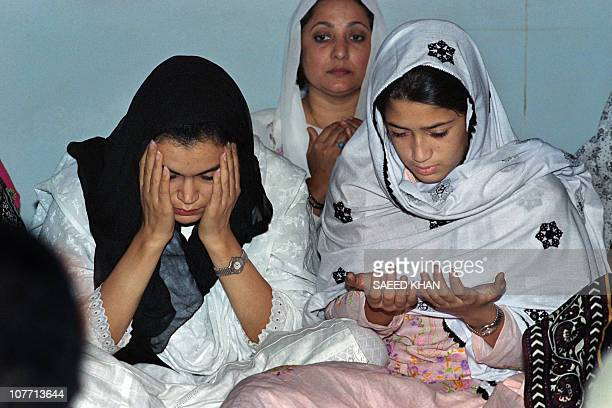 Fatima Bhutto prays for her father Murtaza Bhutto with her mother Ghinwa Bhutto at their residence on September 23 in Larkana Murtaza Bhutto was...