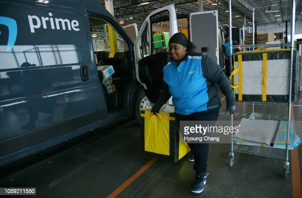 Fatima Fears of Rhion Logistic is loading the boxes to the delivery van at Amazon South Denver Delivery Station November 8 2018 Amazon South Denver...