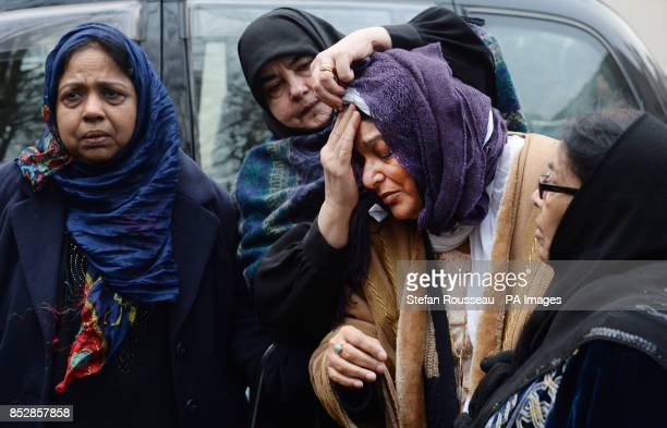 Fatima Khan mother of Dr Abbas Khan 32 who died while being held in custody in Syria is comforted at a service for the British doctor at Regent's...