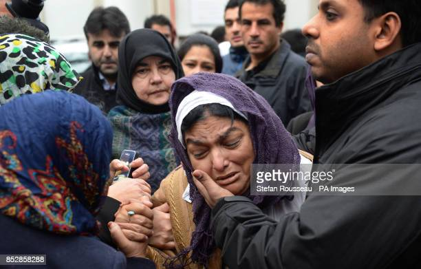 Fatima Khan mother of Dr Abbas Khan 32 who died while being held in custody in Syria is comforted by her son at a service for the British doctor at...